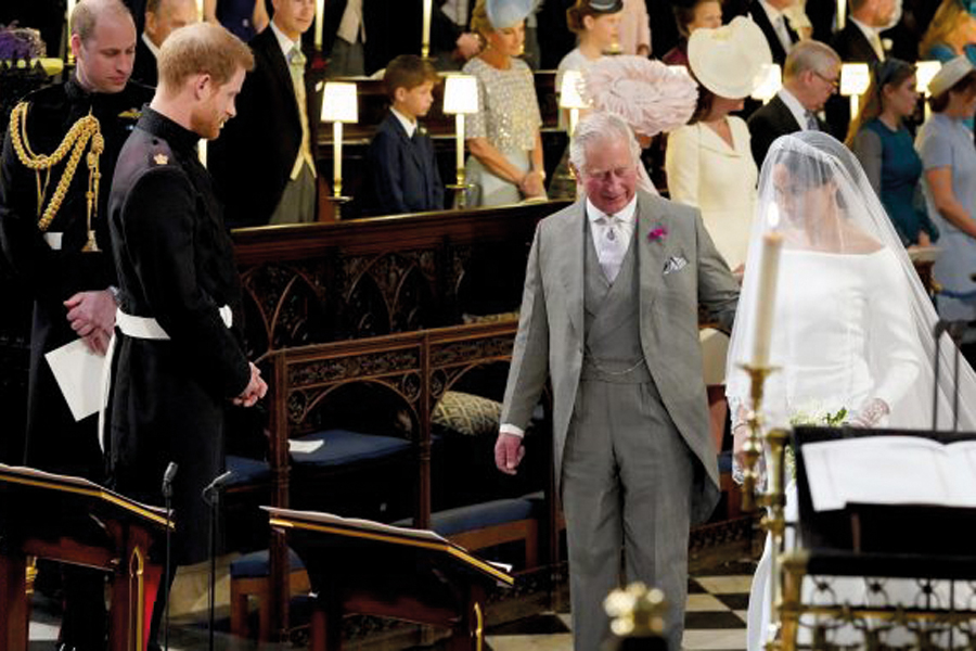 meghan-markle-walks-down-aisle-with-prince-charles-at-royal-wedding-678x381