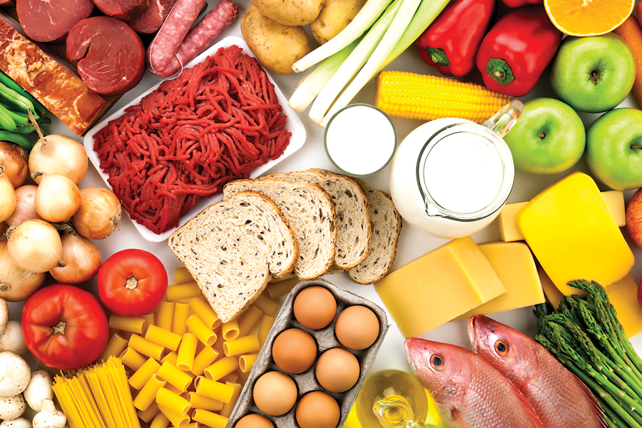 Table filled with different types of foods shot directly above